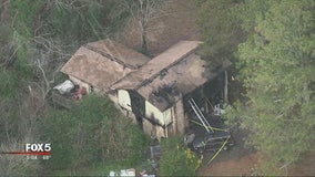 Firefighters pull man from burning Lilburn home