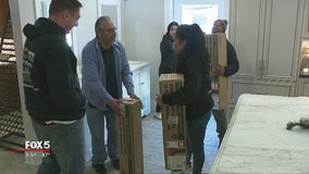 Kennesaw company donates Christmas trees to families