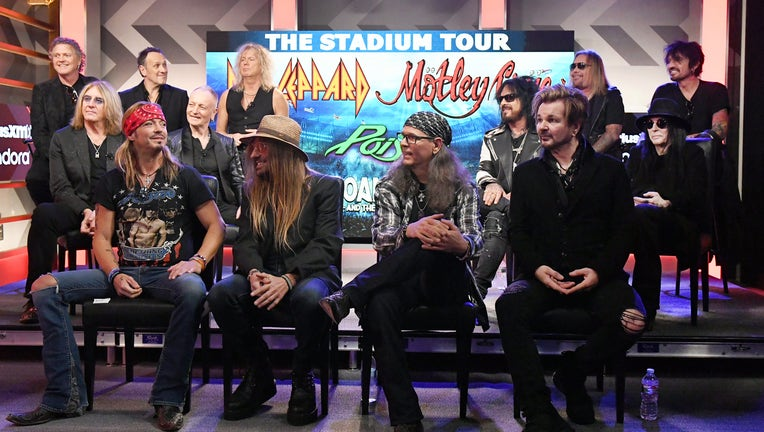 HOLLYWOOD, CALIFORNIA - DECEMBER 04: (Back of stage L-R) Rick Allen, Joe Elliott, Vivian Campbell, Phil Collen, and Rick Savage of Def Leppard, Nikki Sixx, Vince Neil, Mick Mars, and Tommy Lee of Mötley Crüe, and (Front of stage L-R) Bret Michaels, C.C. DeVille, Bobby Dall, and Rikki Rockett of Poison attend the Press Conference with Mötley Crüe, Def Leppard, and Poison announcing 2020 Stadium Tour on December 04, 2019 in Hollywood, California. (Photo by Kevin Winter/Getty Images)