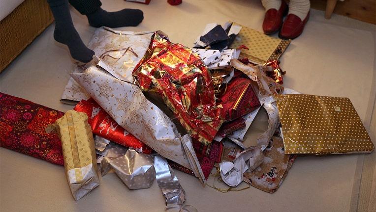 24 December 2018, Bavaria, Kaufbeuren: Packaging paper of Christmas presents lies in a living room on a heap. Photo: Karl-Josef Hildenbrand/dpa (Photo by Karl-Josef Hildenbrand/picture alliance via Getty Images)