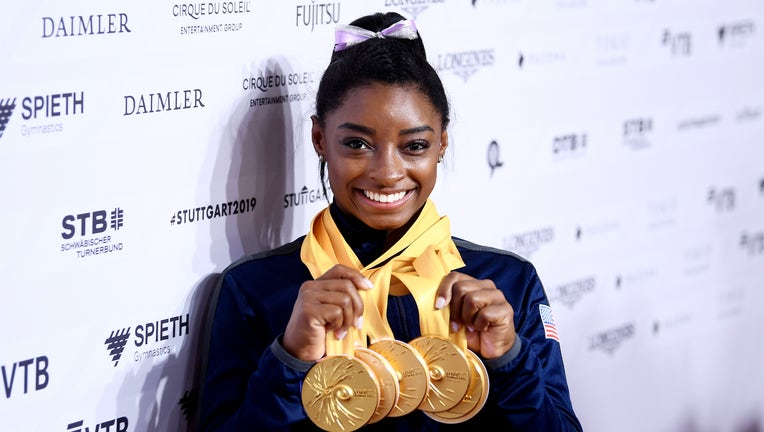 STUTTGART, GERMANY - OCTOBER 13: Simone Biles of The United States poses for photos with her multiple gold medals during day 10 of the 49th FIG Artistic Gymnastics World Championships at Hanns-Martin-Schleyer-Halle on October 13, 2019 in Stuttgart, Germany. (Photo by Laurence Griffiths/Getty Images)