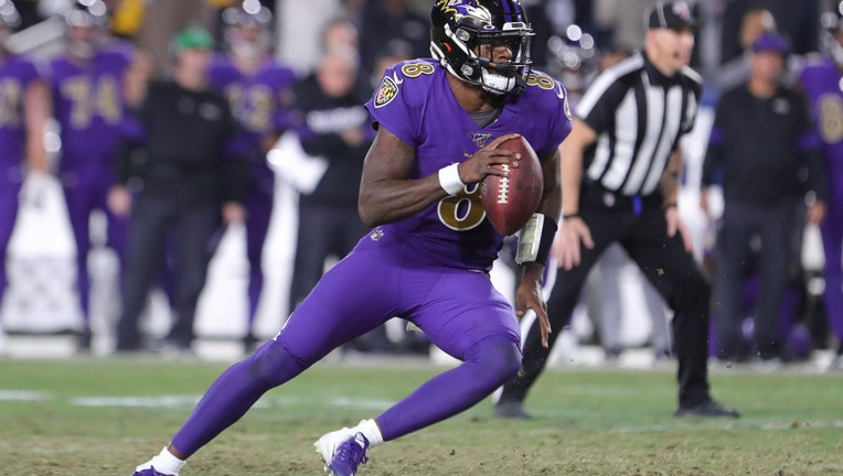 FILE - Quarterback Lamar Jackson #8 of the Baltimore Ravens carries the ball against the Los Angeles Rams at Los Angeles Memorial Coliseum on November 25, 2019 in Los Angeles, California.