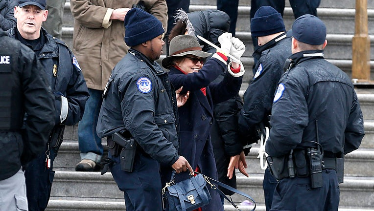 WASHINGTON, DC - DECEMBER 13: Sally Field is arrested during