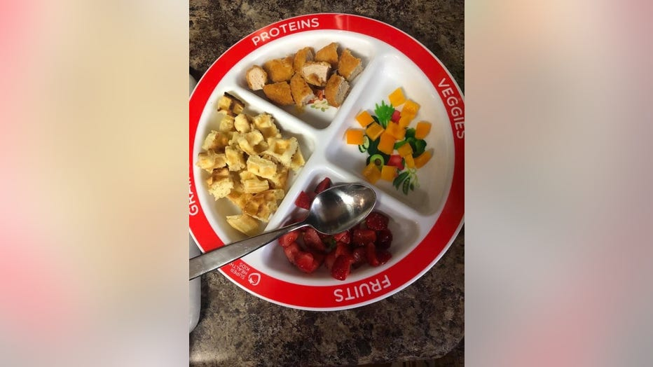 Plate filled with 4 kinds of food