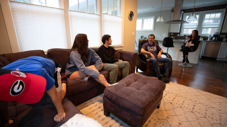 Family gathers in living room
