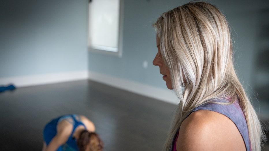 Jennifer Balzano leads a yoga class.