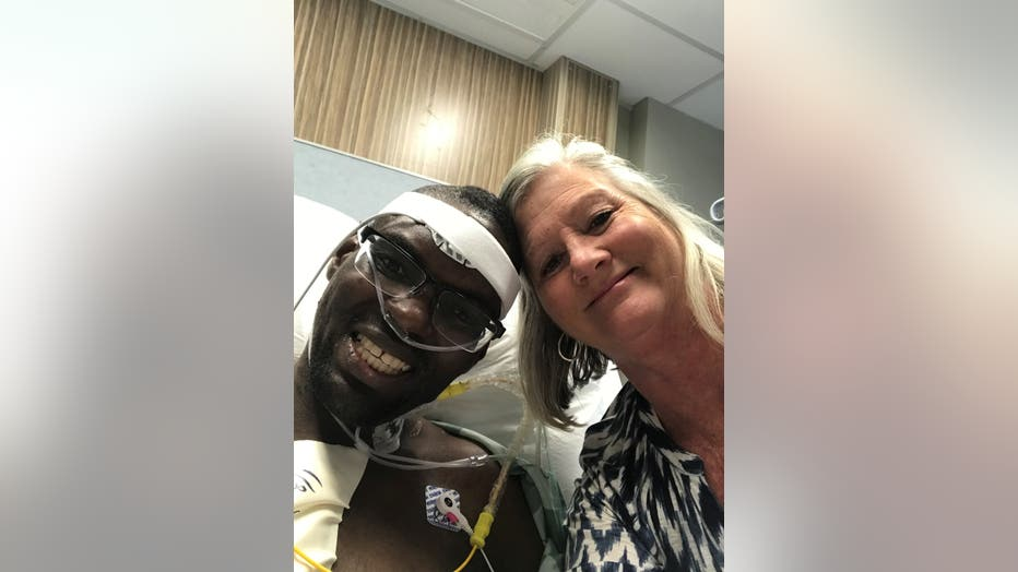 Jonathan Pinkard smiles in hospital bed