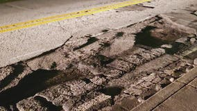 Vehicles damages after hitting large potholes in DeKalb County