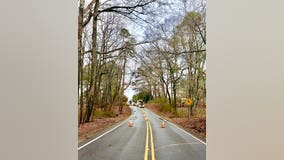 Gas main break shuts down road in Cherokee County