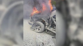 Strangers rescue woman trapped in burning car on I-85