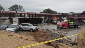 Semi-truck overturns at Gwinnett County gas station