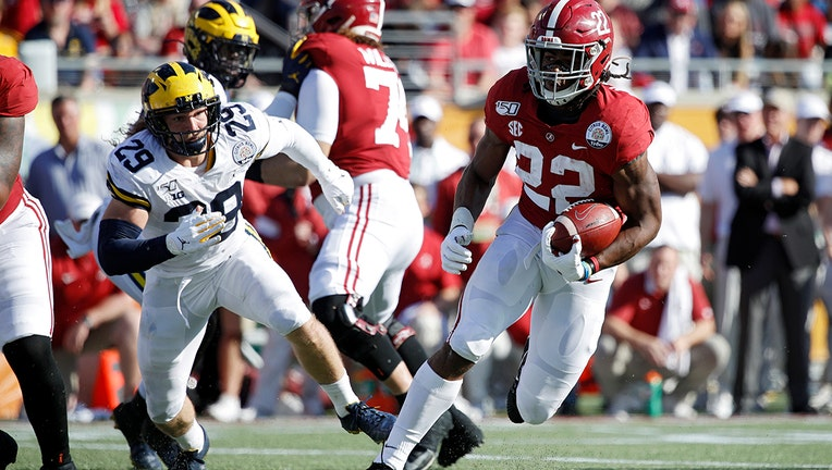 ORLANDO, FL - JANUARY 01: Najee Harris #22 of the Alabama Crimson Tide heads for the end zone on a nine-yard touchdown run against the Michigan Wolverines in the second quarter of the Vrbo Citrus Bowl at Camping World Stadium on January 1, 2020 in Orlando, Florida. (Photo by Joe Robbins/Getty Images)