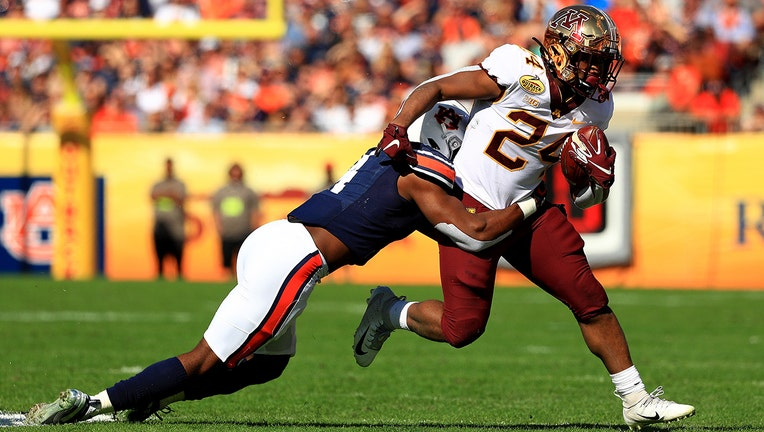 TAMPA, FLORIDA - JANUARY 01: Mohamed Ibrahim #24 of the Minnesota Golden Gophers rushes during the 2020 Outback Bowl against the Auburn Tigers at Raymond James Stadium on January 01, 2020 in Tampa, Florida. (Photo by Mike Ehrmann/Getty Images)