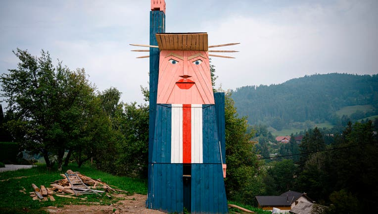 FILE - A wooden structure made to resemble US President Donald Trump is constructed in the village of Sela pri Kamniku, about 20 miles northeast of Ljubljana in Slovenia, the home country of Trump's wife on August 28, 2019.