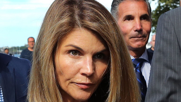 Actress Lori Loughlin leaves a Boston courthouse in August, 2019.