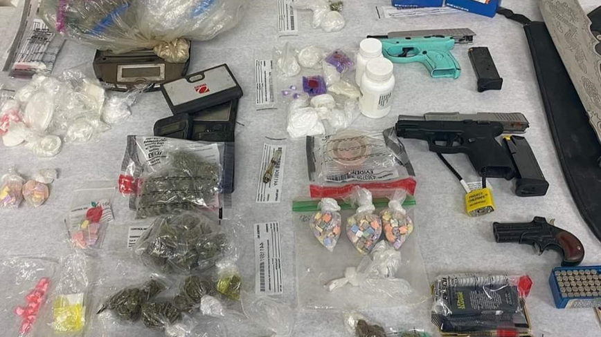 Union City police find drugs, money and guns during house raid