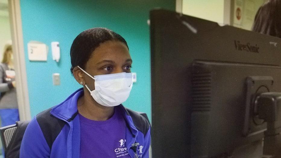 ER nurse wears protective mask during flu season