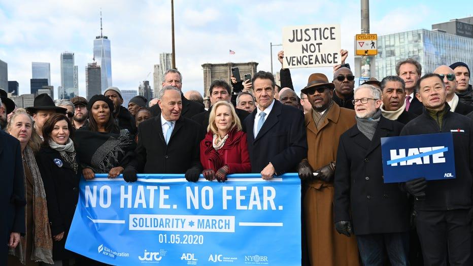 Gov. Andrew Cuomo , Lt. Gov. Kathy Hochul and U.S. Senators Kirsten Gillibrand and Chuck Schumer participate in in the No Fear, No Hate Solidarity March over the Brooklyn Bridge.