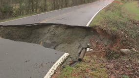 Hall County road washes out, causes water main break