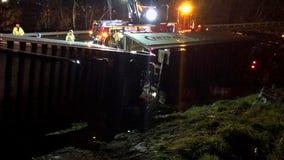 Tractor-trailer rolls over, blocks Spaghetti Junction overnight