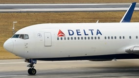 Delta flight to Atlanta grounded after 'unruly' passenger fought with crew, official says