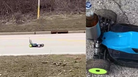 Wisconsin man practices social distancing by sharing beer with neighbor via RC car