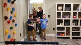 Police officers help surprise 9-year-old with his own therapy room
