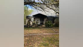 Hall County fire crews work to contain house fire