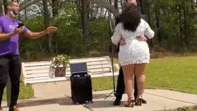 Stranger sings first dance for couple exchanging vows social distance-style at Georgia park