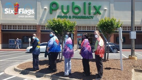Six Flags Over Georgia honors Publix, Kroger employees on National Superhero Day