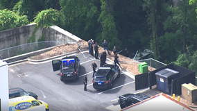 Police: Stolen car chase ends in crash through fence down 20-foot embankment