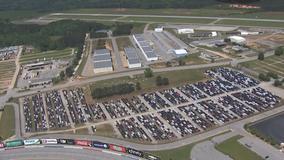 Atlanta Motor Speedway opens parking lot to store hundreds of Enterprise rental cars