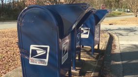 Detectives: 2 arrested for stealing checks from Roswell mailbox