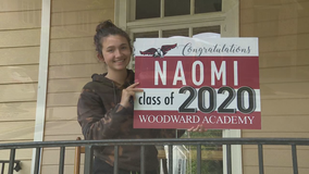 Educators at Woodward Academy hold caravan to deliver special school spirit to seniors