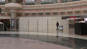 Coronavirus pandemic prompts Atlanta's airport managers to erect temporary walls covering seating