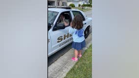 Coweta County deputy shares a sweet moment with his daughter through sign language