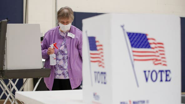 Pandemic politics: Wisconsin voters wait hours at the few open polling stations