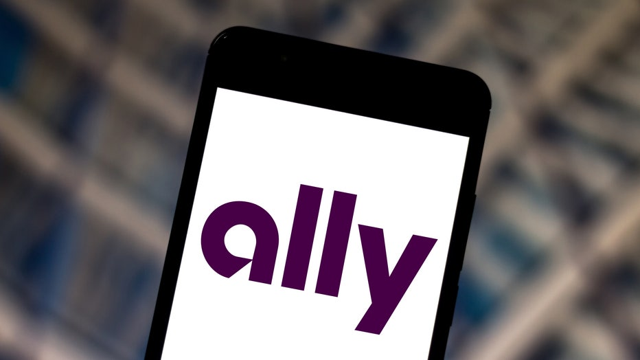 In this photo illustration a Ally Bank logo is displayed on