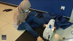 Malaysian woman, born without arms, sews PPE with feet