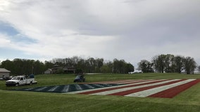 Indiana man paints enormous US flag on field to honor coronavirus health workers
