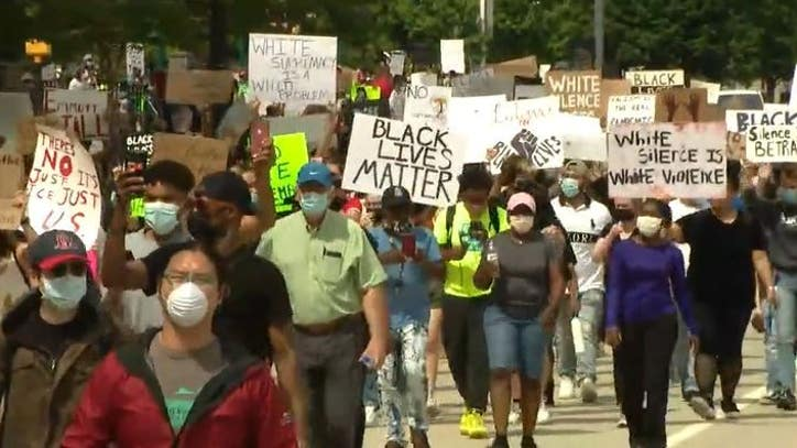 Hundreds descend on Downtown Atlanta to protest against...