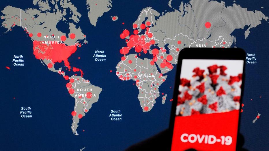 In this photo illustration the Coronavirus COVID-19 Global