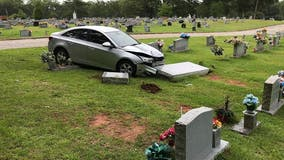 Police search for suspect who stole car, rammed into grave at Carrollton cemetery