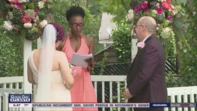 Couple ties the knot with socially distanced wedding