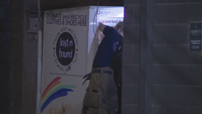 Police: Woman dies after getting trapped in donation box