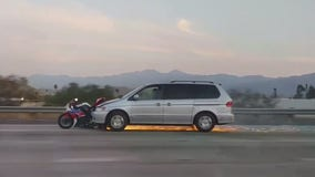 Sparks fly as minivan drags motorcycle along 91 Freeway in Corona