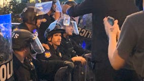 Community leaders react as Phoenix Police officers take a knee with George Floyd protesters