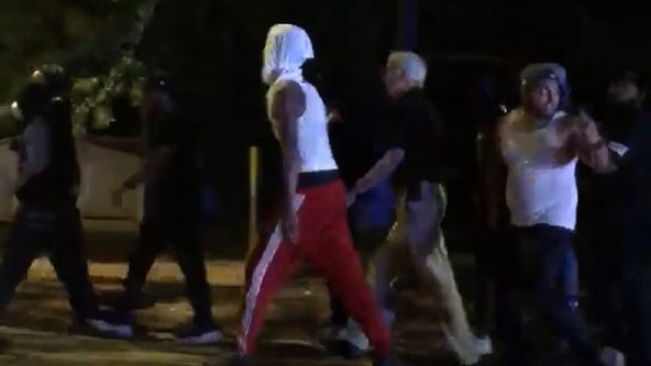 Video shows Gwinnett County sheriff walking with protesters
