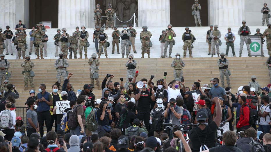 66893b97-U.S. Cities Clean Up Damage As Riots Continue Across The Country