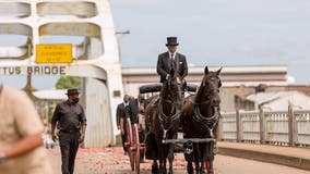 John Lewis makes final journey across Edmund Pettus Bridge in processional